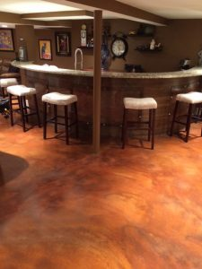 stained concrete floors in a bar with mono chairs